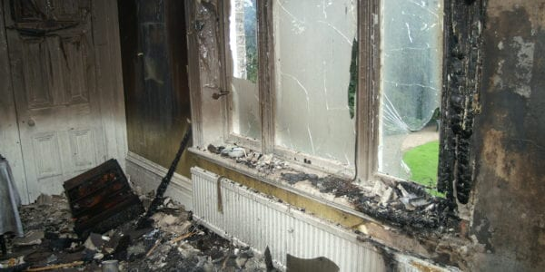 fire damaged living room - Regency DKI